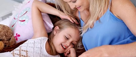 mom laying with daughter