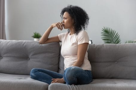 woman worrying on couch