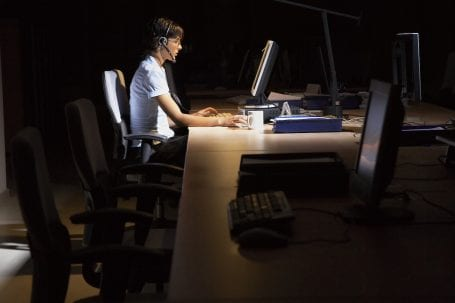 woman working at a desk at night