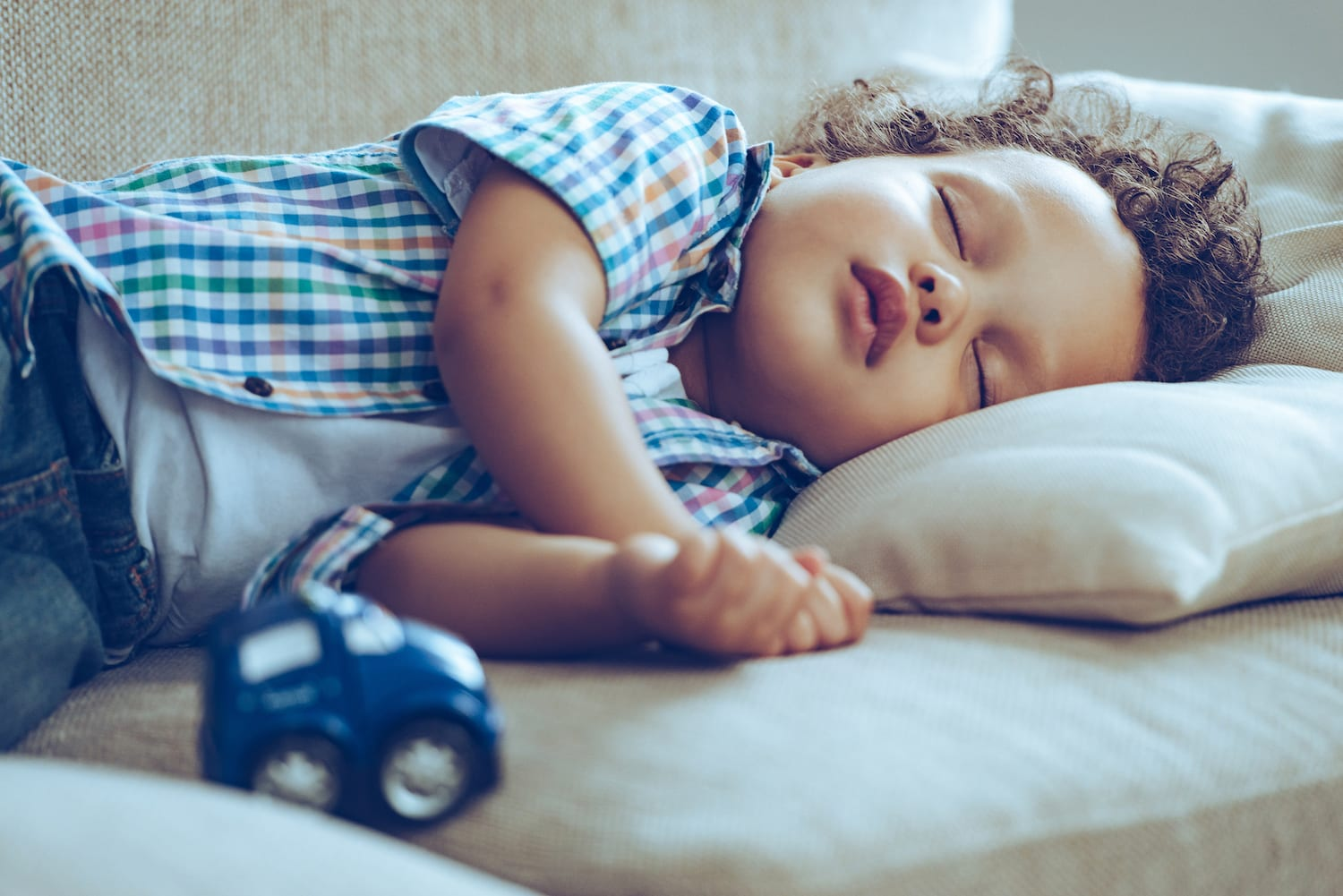 baby napping on couch