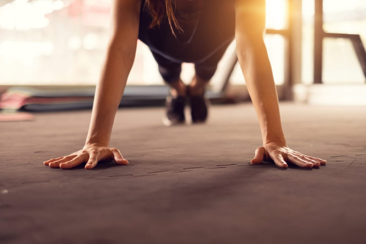 Woman push ups in gym