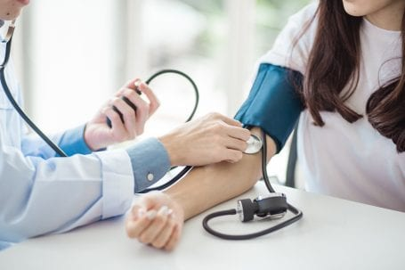 woman getting her blood pressure checked