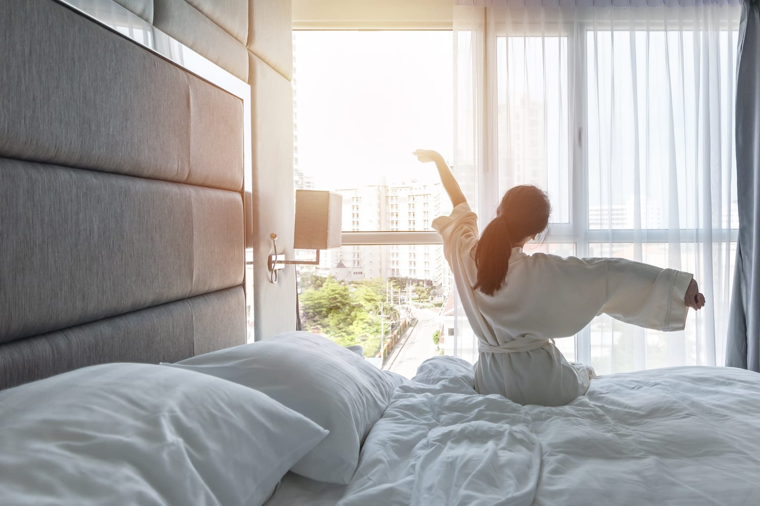 woman waking up in a hotel