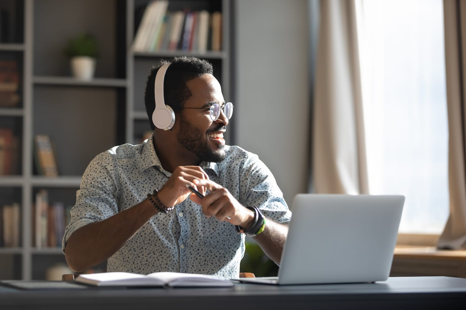 Man working from home with laptop and headphones