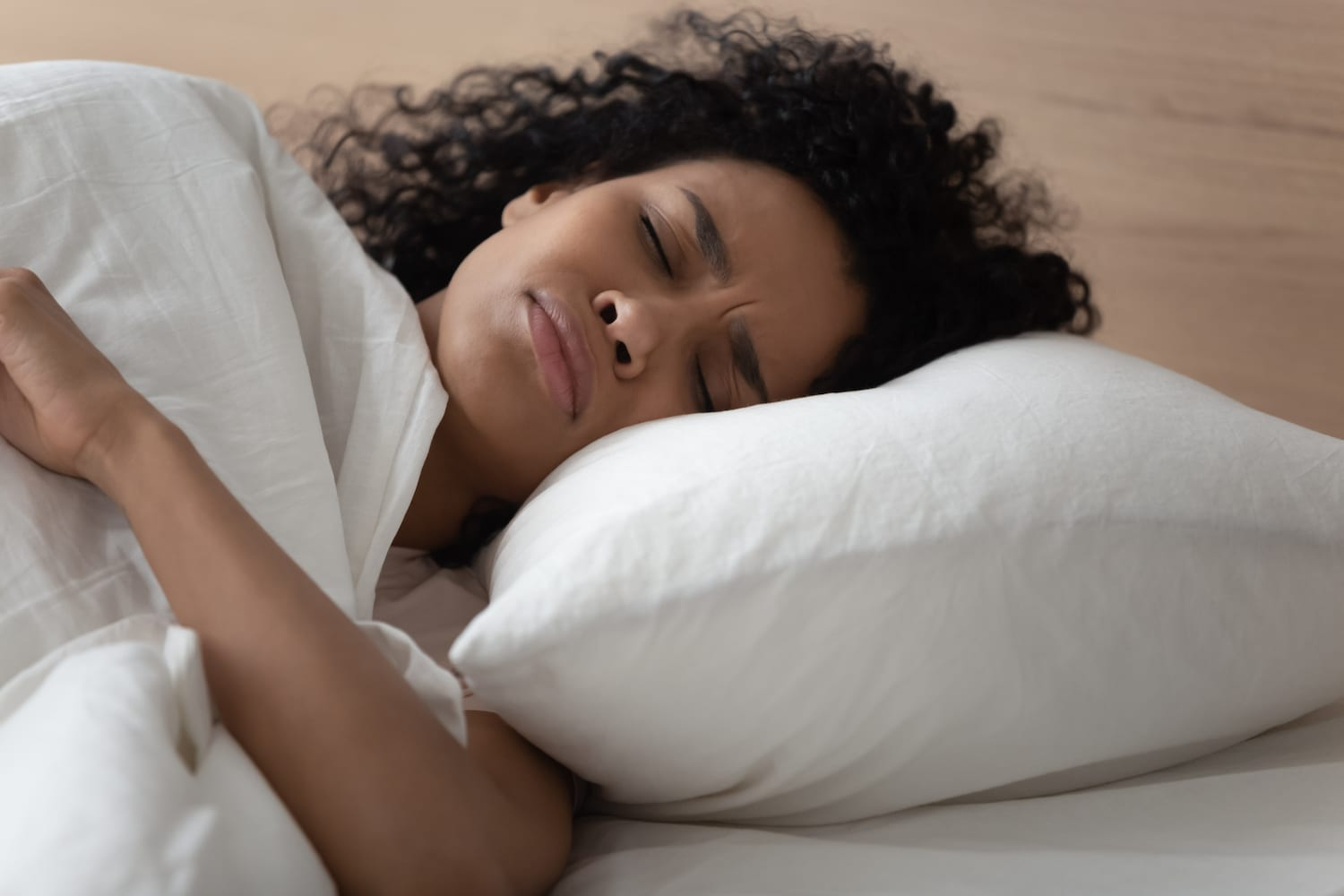 Woman having breathing problems while sleeping