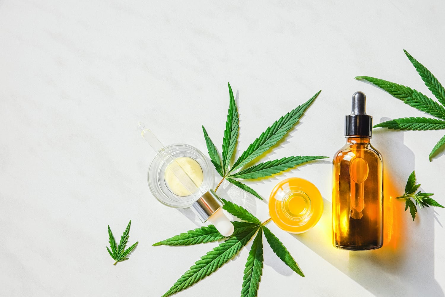 CBD oil and marijuana leaves