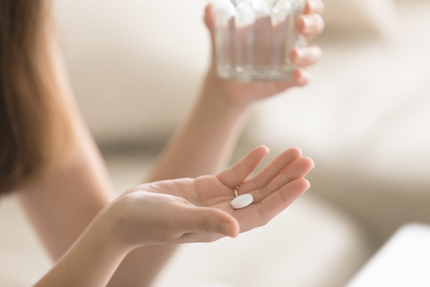 White pill in woman's hand