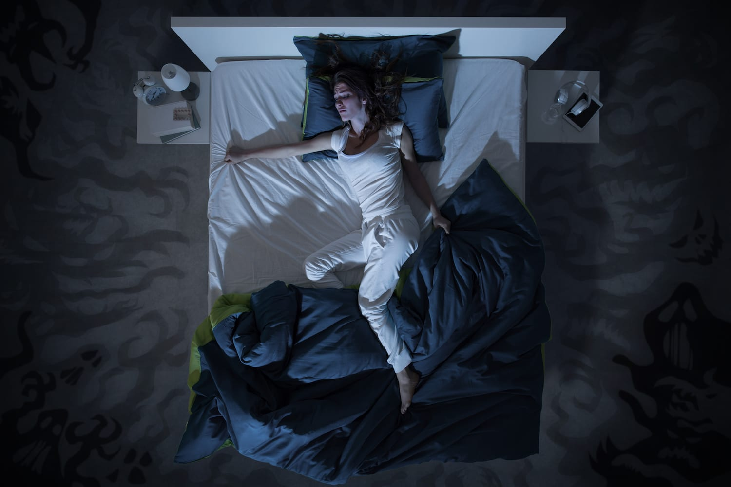 Woman tossing and turning in bed with a fever