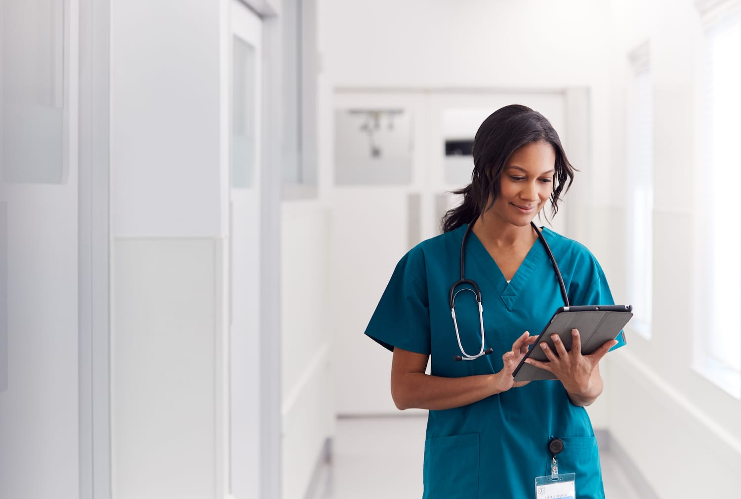 Female doctor looking at tablet