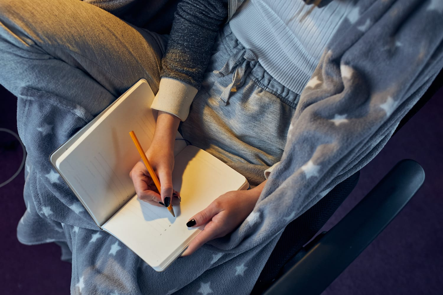 Woman writing in dream journal