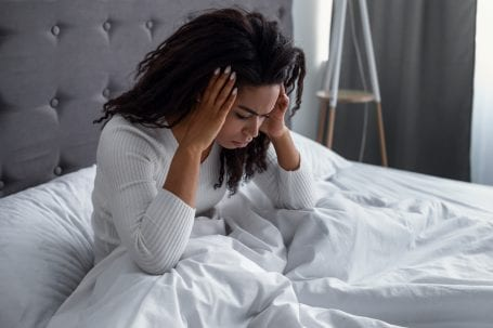 Woman waking up with a headache