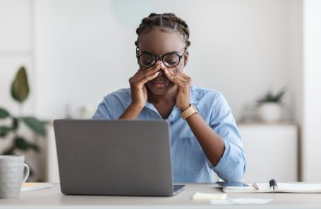 Woman tired at her computer